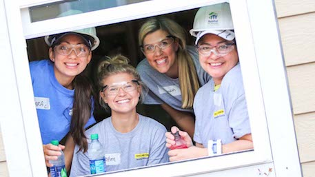 Volunteers at Habitat build window